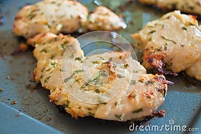 Garlic chicken on cooking pan