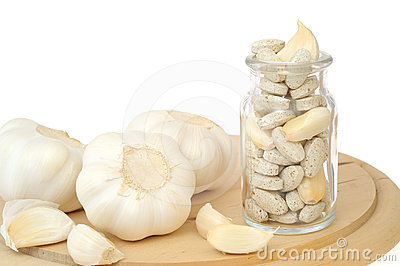 Garlic and herbal supplement pills isolated