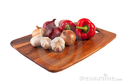 Garlic, onion and pepper on cutting board