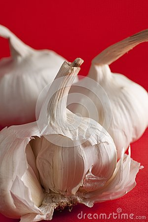 Garlic on red background, half clove