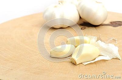 Garlic on a wooden cutting board