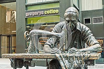 The garment worker - sculpture by Judith Weller Editorial Image