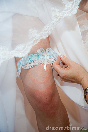 Garter on leg of bride