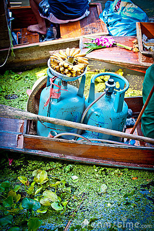 Gas bottles in a small boat in the floating market