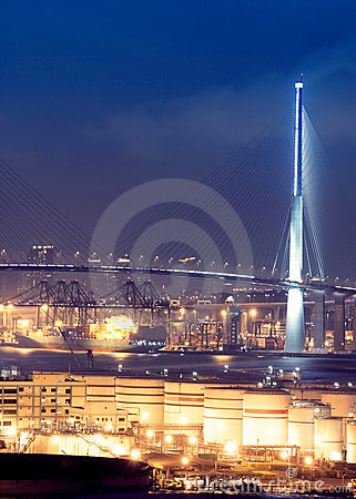 Gas container and bridge at night