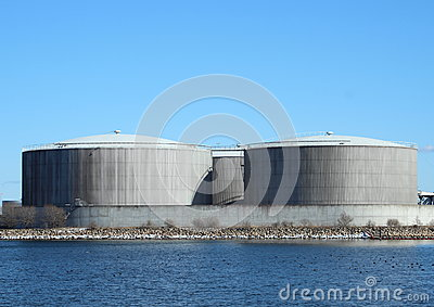 Gas containers at energy plant with lake and blue