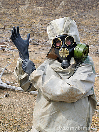 Gas mask, gloves, the person