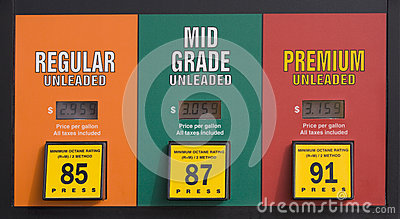 gas prices at a pump stock photo image 69403566. Black Bedroom Furniture Sets. Home Design Ideas