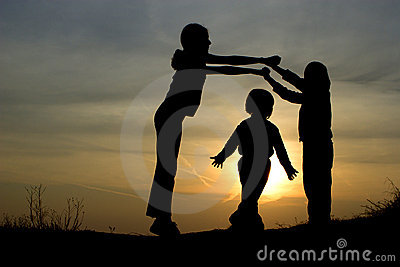 Gate - silhouette of children by play in sunset