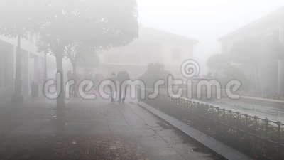 Gathering on a foggy day. Meeting in the town square on a foggy day. Torrelodones, Madrid, Spain stock footage