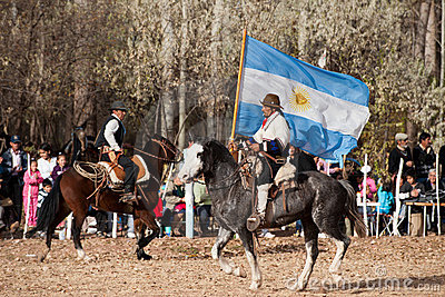 A Gaucho with Argentinian flag riding a horse in e Editorial Stock Image