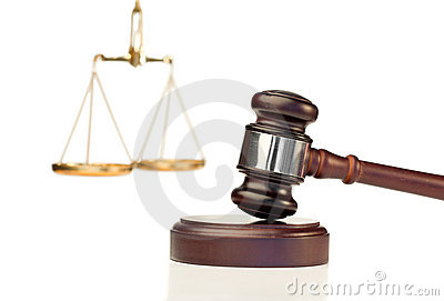 Gavel in action and scale of justice