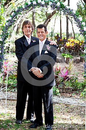 Free Gay Couple Under Wedding Arch Royalty Free Stock Images - 25876959
