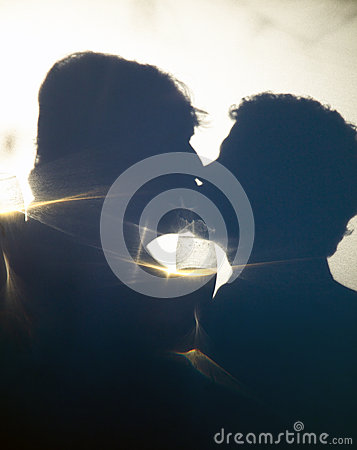 Gay Male Couple Romantic Kiss in Silhouette