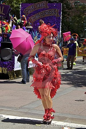 Gay Pride Participant In Bright Red Costume Editorial Stock Image