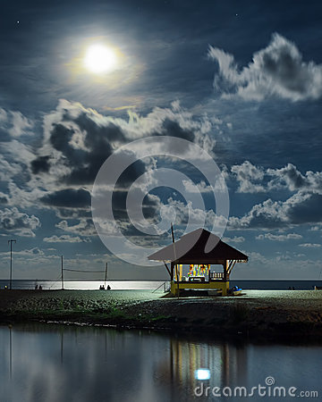 Gazebo and moon in water s reflection. Night landscape