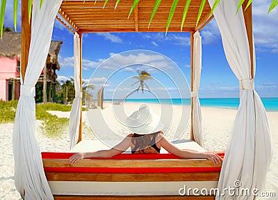 Gazebo tropical beach woman rear view looking sea