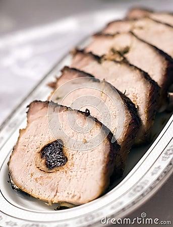 Gebakken varkensvlees met pruim