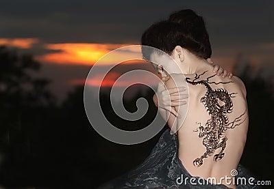 Geisha with dragon tattoo