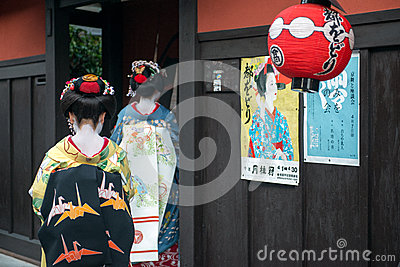 Geisha enter famous tea house Editorial Stock Photo