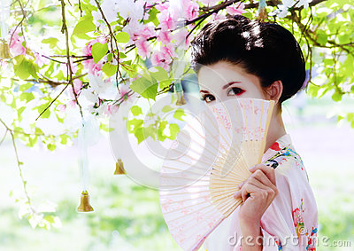 Geisha with fan in the garden