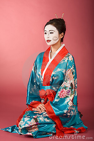 Geisha Japanese woman in kimono and facepaint