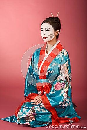 Geisha Japanese woman in kimono and facepaint