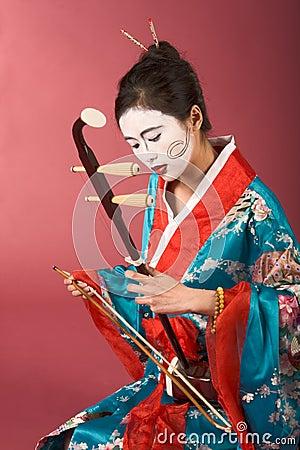 Geisha in kimono with erhu