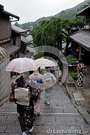 Free Geishas Walking With Umbrella In The Rain Stock Photos - 126930133