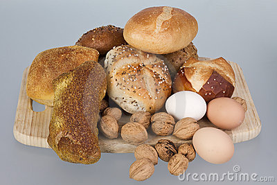 Gem, nuts and eggs on a wooden board