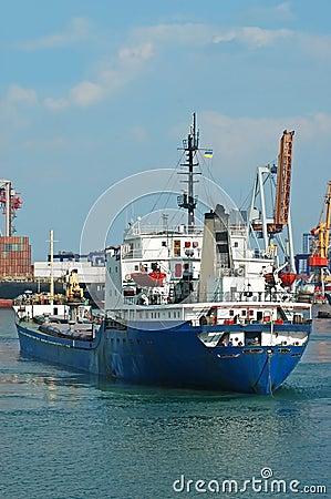 General cargo ship and port crane
