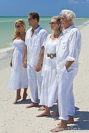 Generations of Family Holding Hands on a Beach