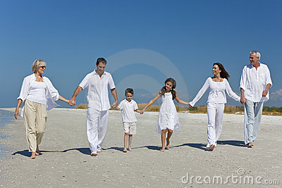 Generations of Family Holding Hands on Beach