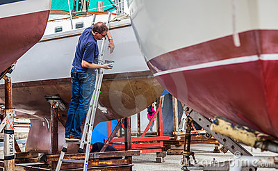 Geneva Waterfront View -Man Fixing Boat Editorial Stock Photo