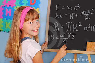 Genius schoolgirl writing on blackboard