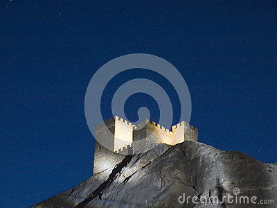 Genoese fortress illuminated in the mountains at night