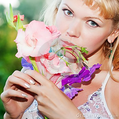 Gentle erotic woman with flowers