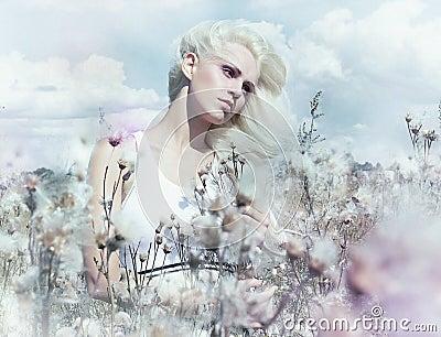 Gentle girl in the lush flowering field