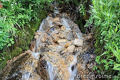 Gentle hillside waterfall