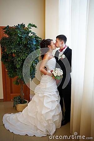 Gentle kiss bride and groom
