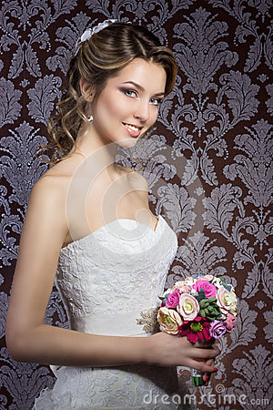 Free Gentle Portrait Of Happy Smiling Beautiful Sexy Girls In White Wedding Dress With A Wedding Bouquet In Hand With Beautiful Hair Stock Photos - 51243903