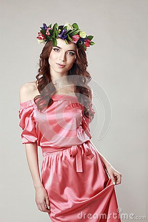 Free Gentle Romantic Appearance Of The Girl With A Wreath Of Roses On Her Head And A Pink Dress. Joyful Jolly Spring Woman. Summer Lady Royalty Free Stock Photo - 85341295