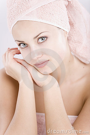 Gentle young woman with towel on her head