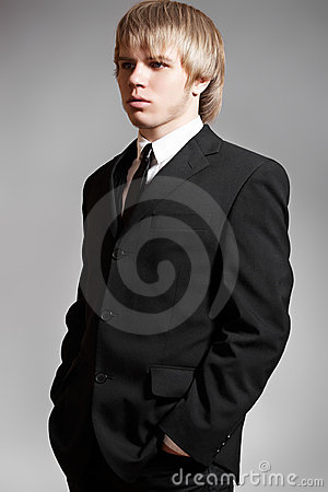 Gentleman business man model in elegant black suit