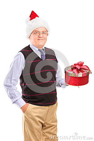 Gentleman with christmas hat holding gift