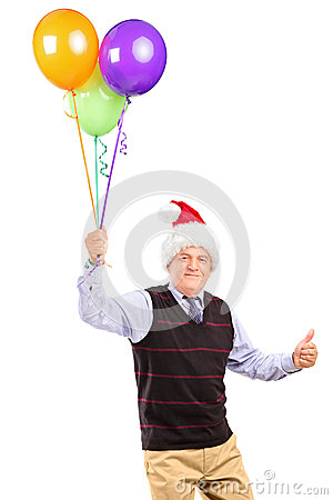 Gentleman holding balloons and giving thumb up