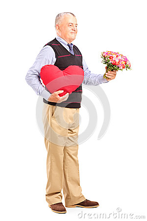 Gentleman holding a red heart and flowers