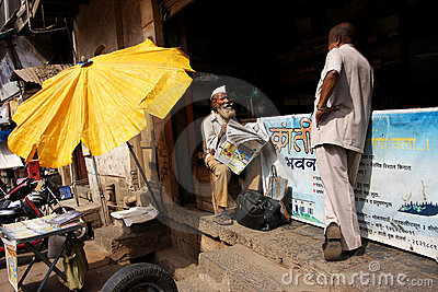 Gentleman with the newspaper in Mumbai Editorial Photo