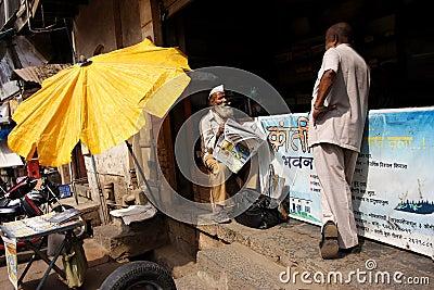 Gentleman with the newspaper in Mumbai Editorial Photo