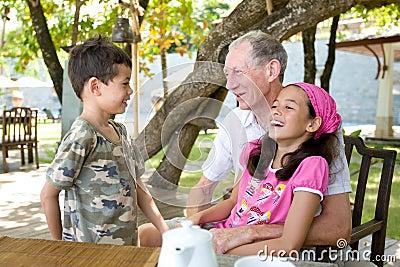 Gentleman spending time with grandchildren